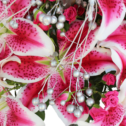 Lilies and Bling Holiday Flowers