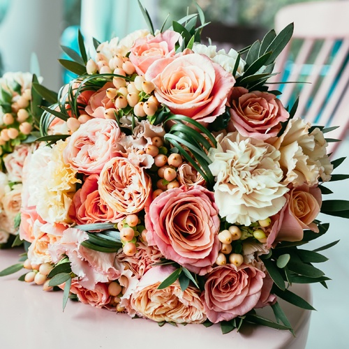 Coral and White Carnations and Roses up close