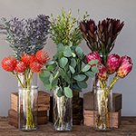 Sunset Lagoon DIY wedding flowers in vases