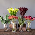 Tropical Protea DIY wedding flowers in vases