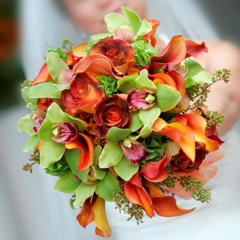 Roses and Orchids Wedding Bouquet in hand