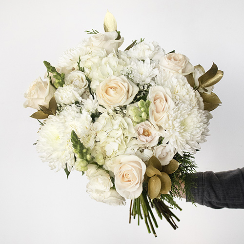 fresh white roses with white hydrangeas in a centerpiece